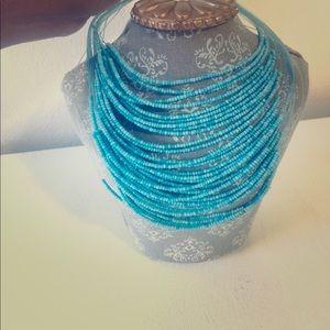 NWOT. Blue Multi-String Beaded Necklace